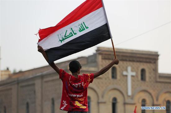 A protester is seen during a protest at Tahrir square in Baghdad, Iraq, on Oct. 29, 2019. The UN Secretary-General's Special Representative for Iraq Jeanine Hennis-Plasschaert on Tuesday called for holding national dialogue to resolve the ongoing anti-government protests in Iraq. (Xinhua/Khalil Dawood)