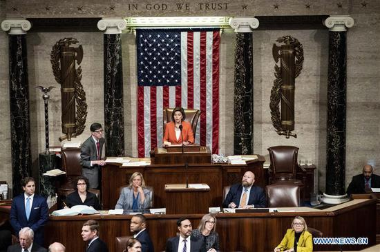 U.S. House Speaker Nancy Pelosi (rear, C) presides over a vote by the House of Representatives on a resolution formalizing an impeachment inquiry into President Donald Trump, on Capitol Hill in Washington D.C., the United States, on Oct. 31, 2019. The U.S. House of Representatives voted on Thursday to approve a resolution designed to formalize proceedings of an impeachment inquiry into President Donald Trump. (Melina Mara/Pool via Xinhua)