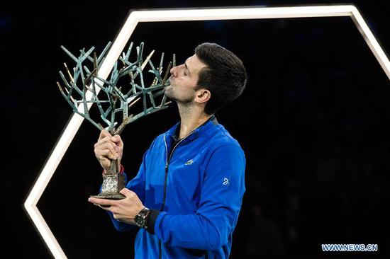 Novak Djokovic of Serbia kisses the trophy after the final match against Denis Shapovalov of Canada at the Rolex Paris Masters 1000 held at the AccorHotels Arena in Paris, France, Nov. 3, 2019. (Photo by Aurelien Morissard/Xinhua)