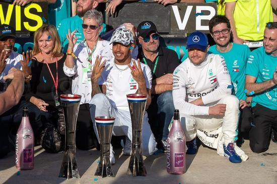 Lewis Hamilton (C) celebrates his sixth F1 world title following the F1 Grand Prix of USA at Circuit of The Americas in Austin, Texas on November 03, 2019. [Photo: VCG]