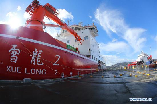 China's polar icebreakers Xuelong (R), or Snow Dragon , and Xuelong 2 are seen docked at the port of Hobart, Australia, Nov. 7, 2019. China's polar icebreaker Xuelong 2, or Snow Dragon 2, docked at the port of Hobart on Nov. 4. Both Xuelong and Xuelong 2 joined the country's 36th Antarctic expedition, marking the first time for two polar icebreakers to work together on China's Antarctic expedition. After their first encounter in Hobart, the two icebreakers will meet again at the Zhongshan Station. (Xinhua/Liu Shiping)