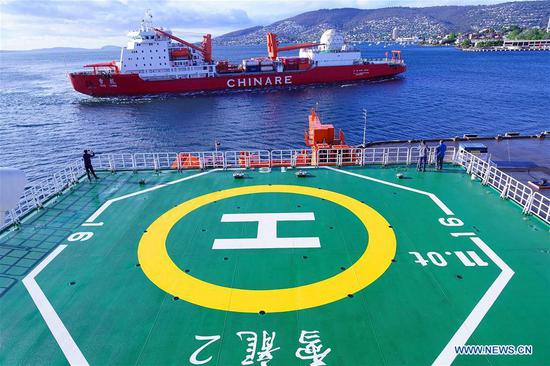 Photo taken on Nov. 7, 2019 from China's polar icebreaker Xuelong 2, or Snow Dragon 2, shows icebreaker Xuelongge near the port of Hobart, Australia. China's polar icebreaker Xuelong 2, or Snow Dragon 2, docked at the port of Hobart on Nov. 4. Both Xuelong and Xuelong 2 joined the country's 36th Antarctic expedition, marking the first time for two polar icebreakers to work together on China's Antarctic expedition. After their first encounter in Hobart, the two icebreakers will meet again at the Zhongshan Station. (Xinhua/Liu Shiping)