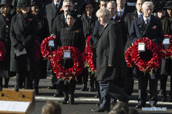 British Prime Minister Boris Johnson attends the Remembrance Sunday Service in London, Britain, on Nov. 10, 2019. The Remembrance Sunday ceremony is an annual event to pay tribute to the war dead of Britain and the Commonwealth, which is held on the nearest Sunday to the anniversary of the end of World War I on Nov. 11, 1918. (Photo by Ray Tang/Xinhua)