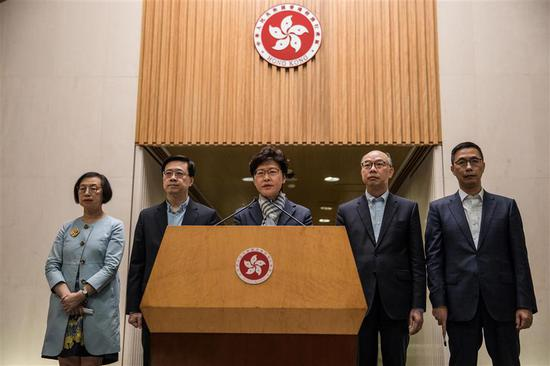 Hong Kong Chief Executive Carrie Lam (center) speaks at a press conference yesterday. She condemned violent protesters who are relentlessly destroying Hong Kong society and called for people to stay calm.