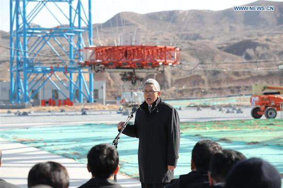 Zhang Rongqiao, chief architect of the Mars mission, speaks at the trial ground of an experiment for landing on Mars in Huailai County, north China's Hebei Province, Nov. 14, 2019. China on Thursday unveiled an experiment simulating the process of a probe hovering, avoiding obstacles and descending to land on Mars. China plans to launch the Mars probe in 2020, aiming to complete orbiting, landing and roving in one mission, an unprecedented achievement, according to the China National Space Administration. How to safely land on Mars is one of the biggest challenges facing the mission. The experiment simulated the gravity of Mars, about one-third of the gravity on Earth, to test the design of the lander. (Xinhua/Jin Liwang)