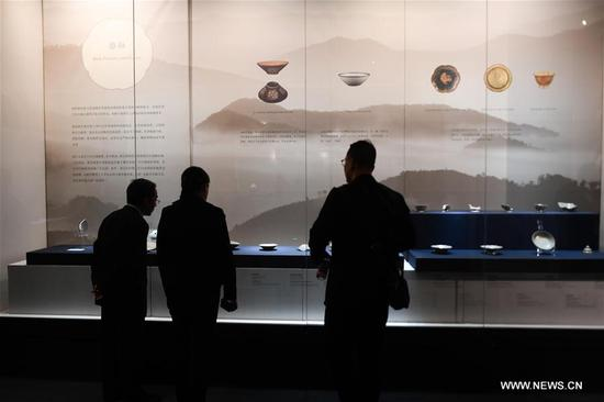 Visitors appreciate celadon porcelain works during a Yue kiln 's celadon porcelain exhibition at Cixi Museum in Cixi, east China's Zhejiang Province, Nov. 14, 2019. More than 40 pieces of celadon porcelain from different cultural units are displayed during the exhibition, which will last till Feb. 1, 2020. (Xinhua/Huang Zongzhi)