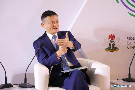 Jack Ma, the founder of China's e-commerce giant Alibaba, speaks at the Nigeria Digital Economy Summit in Abuja, Nigeria, on Nov. 14, 2019. Jack Ma pledged on Thursday to promote an inclusive digital economy in Africa. (Photo by Jiang Xuan/Xinhua)