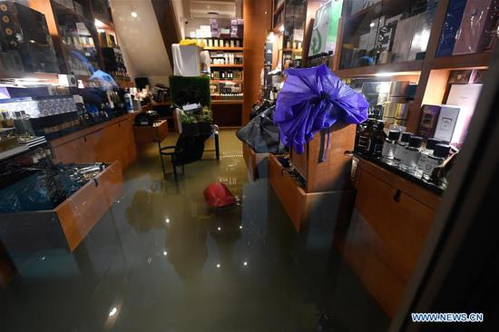 A shop flooded with water is seen in Venice, Italy, Nov. 15, 2019. The Italian government declared a state of emergency in Venice, after the ancient lagoon city was severely flooded earlier this week, Prime Minister Giuseppe Conte said on Thursday. At least two people died and severe damages were registered in Italy's lagoon city of Venice, following the highest water tide since 1960s, local authorities said on Wednesday. (Photo by Alberto Lingria/Xinhua)