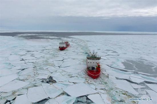Aerial photo taken on Nov. 20, 2019 shows China's polar icebreakers Xuelong 2 (R) and Xuelong sailing towards the Zhongshan Station in Antarctica. China's polar icebreakers Xuelong and Xuelong 2 on Wednesday reached the waters near the Zhongshan Station in Antarctica. (Xinhua/Liu Shiping)