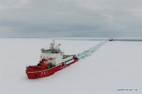Aerial photo taken on Nov. 20, 2019 shows China's polar icebreaker Xuelong 2 (front) breaking ice near the coast of Antarctica. China's polar icebreakers Xuelong and Xuelong 2 on Wednesday reached the waters near the Zhongshan Station in Antarctica. (Xinhua/Liu Shiping)