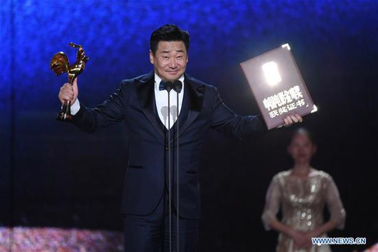 Wang Jingchun is honored with the Best Actor Award for the movie
