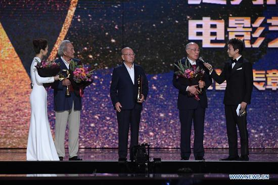 Yang Zaibao (2nd L), Wang Tiecheng (C) and Xu Huanshan (2nd R) are honorned with the Lifetime Achievement Award at the awarding ceremony of the 32nd China Film Golden Rooster Awards held in Xiamen, southeast China's Fujian Province, Nov. 23, 2019. (Xinhua/Jiang Kehong)