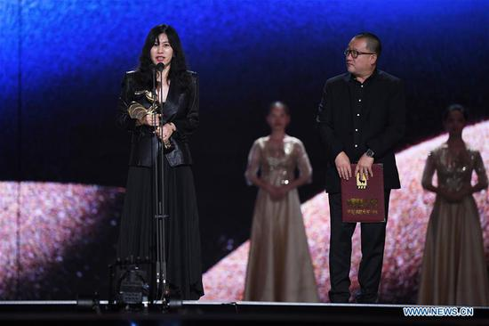 Wang Xiaoshuai (R), director and scriptwriter of the film