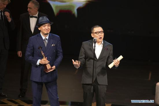 Director Zhang Chong (front, L) and Zhang Bo (front, R) of Chinese movie
