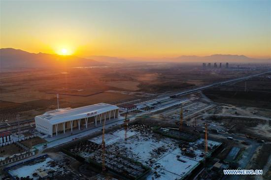 Aerial photo taken on Nov. 27, 2019 shows the Huailai Station along the Beijing-Zhangjiakou high-speed railway in Zhangjiakou, north China's Hebei Province. The construction of each station along the Beijing-Zhangjiakou high-speed railway is to be completed soon, following the operational test of each station. (Xinhua/Xing Guangli)
