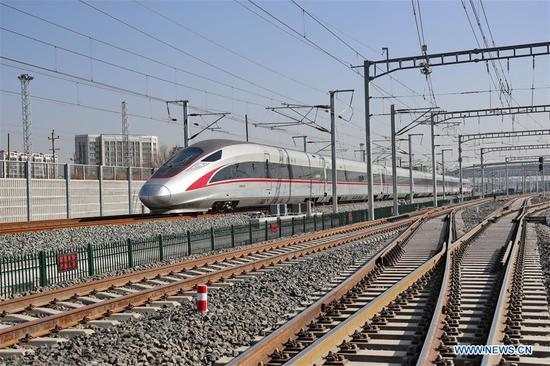 Photo taken on Nov. 15, 2019 shows a high-speed train running on the Beijing-Zhangjiakou high-speed railway in Zhangjiakou, north China's Hebei Province. The construction of each station along the Beijing-Zhangjiakou high-speed railway is to be completed soon, following the operational test of each station. (Xinhua/Yang Shiyao)
