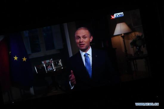 Photo taken on Dec. 1, 2019 shows a TV set displaying Maltese Prime Minister Joseph Muscat in a recorded televised address on the national television station Television Malta (TVM). Joseph Muscat announced on Sunday his decision to resign from office after January 12, when a new leader is chosen for the Labor Party and could replace him as prime minister. (Photo by Jonathan Borg/Xinhua)