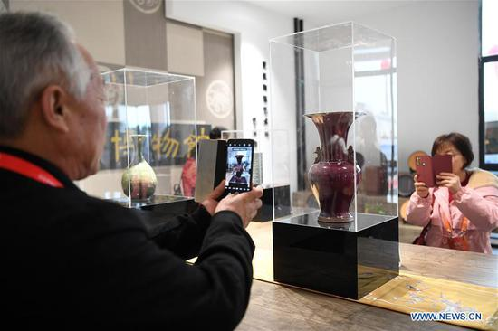 Visitors take photos of a ceramic artwork at the Belt and Road Ceramic Expo Center in Rongchang District of southwest China's Chongqing Municipality, Dec. 1, 2019. The Belt and Road Ceramic Expo Center displaying more than 2,000 ceramic artworks, was open to public on Sunday. (Xinhua/Tang Yi)