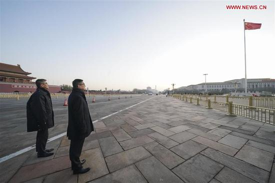 Tang Ping-keung (R), the new commissioner of police of China's Hong Kong Special Administrative Region (HKSAR), leads a delegation of the Hong Kong Police Force to watch the flag-raising ceremony in Beijing, capital of China, on Dec. 7, 2019. (Xinhua/Yin Gang)