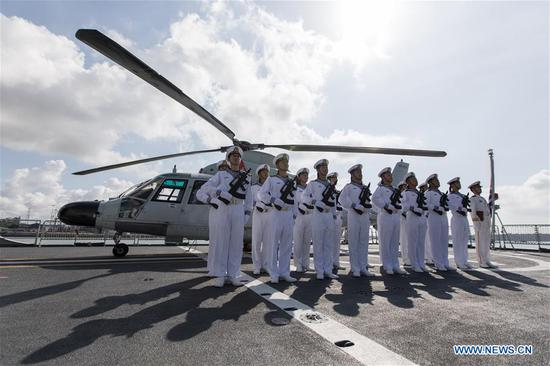 Chinese soldiers stand in formation aboard missile frigate Weifang at the port of Mombasa, Kenya, Dec. 8, 2019. The missile frigate Weifang from the 33rd escort fleet of the Chinese People's Liberation Army (PLA) Navy arrived at the port of Mombasa, Kenya for technical docking Sunday morning. (Xinhua/Xie Han)