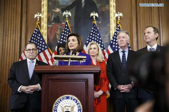 U.S. House Speaker Nancy Pelosi (C, Front) speaks at a news conference to announce articles of impeachment against U.S. President Donald Trump on Capitol Hill in Washington D.C., the United States, on Dec. 10, 2019. U.S. House Democrats on Tuesday moved forward by announcing two articles of impeachment, accusing U.S. President Donald Trump of abuse of power and obstruction of Congress, culminating over two months of investigation by Democrat-led House committees into the president's dealings with Ukraine. (Photo by Ting Shen/Xinhua)