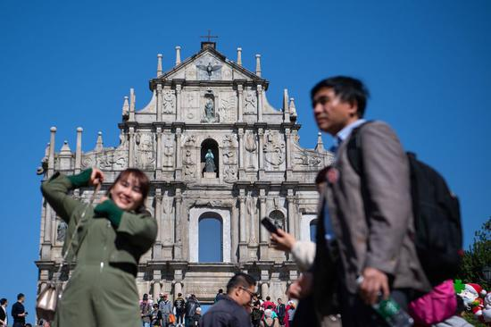 People visit the Ruins of St. Paul's complex in Macao, south China, Dec. 12, 2019. (Xinhua/Cheong Kam Ka)