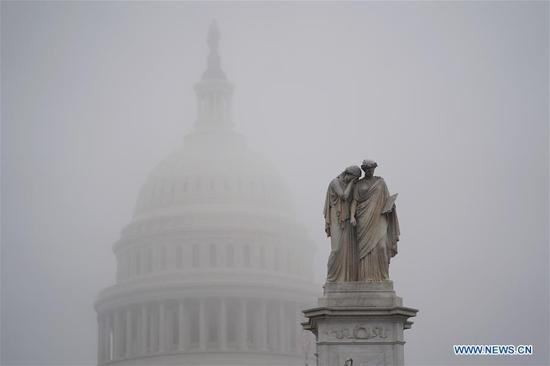 "The Capitol Hill is shrouded in fog in Washington D.C., the United States, on Dec. 17, 2019. U.S. President Donald Trump on Tuesday sent a six-page letter to House Speaker Nancy Pelosi, slamming the House Democrats impeachment effort as an ""illegal, partisan attempted coup"" and an ""unprecedented and unconstitutional abuse of power."" (Xinhua/Liu Jie)"