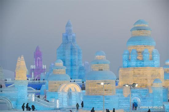 People visit the 36th Harbin Ice and Snow Festival at Harbin Ice-Snow World in Harbin, capital of China's northernmost Heilongjiang Province, Jan. 5, 2020. The annual Harbin Ice and Snow Festival opened to public here on Sunday. (Xinhua/Zhang Tao)