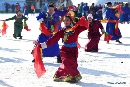 People perform on the opening ceremony of the 13th winter fishing and traveling festival at Dali Nur in Chifeng, north China's Inner Mongolia Autonomous Region, Jan. 5, 2020. (Photo by Li Zhipeng/Xinhua)