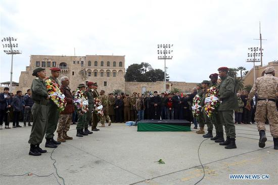 People attend a mourning ceremony for students killed in an air strike on a military academy in Tripoli, Libya, on Jan. 5, 2020. On Saturday, 30 students were killed and 33 others were injured in an air strike that hit the military academy in Tripoli, according to the Ministry of Health of the UN-backed government. (Photo by Hamza Turkia/Xinhua)