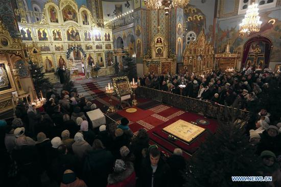 People attend a Christmas service at Riga Nativity of Christ Orthodox Cathedral in Riga, Latvia, on Jan. 6, 2020. Orthodox Christians celebrate Christmas on Jan. 7 according to the Julian calendar. (Photo by Edijs Palens/Xinhua)
