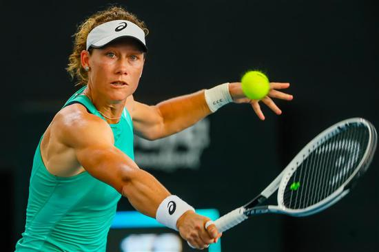 Samantha Stosur hits a return against Angelique Kerber of Germany during their first-round match at the Brisbane International in Brisbane, Australia, on Monday. The home favorite won 7-6 (5), 7-6 (4).