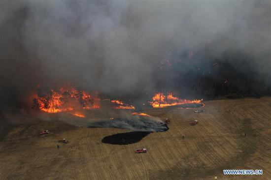 Photo taken on Dec. 20, 2019 shows fire trucks working at Lexton bush fire site in western Victoria, Australia. The Australian government launched the National Bushfire Recovery Agency which would be funded with an initial two billion Australian dollars (1.38 billion U.S. dollars) on Monday. (Wayne Riggs/CFA/Handout via Xinhua)