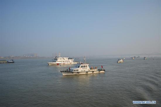 Fishery administrative boats cruise to inspect the implementation of fishing ban in the Yangtze River on Jan. 8, 2020. China on Jan. 1 began a 10-year fishing ban on key areas of the Yangtze River to protect biodiversity in the country's longest river. (Photo by Cao Yaxuan/Xinhua)