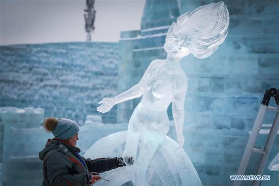 A competitor from Russia creates a work during the 34th Harbin International Ice Sculpture Competition in the Harbin Ice and Snow World in Harbin, northeast China's Heilongjiang Province, Jan. 8, 2020. The 34th Harbin International Ice Sculpture Competition concluded in Harbin on Wednesday. The ice sculpture made by a Russian team won the first prize at the end of the competition. (Xinhua/Wang Song)