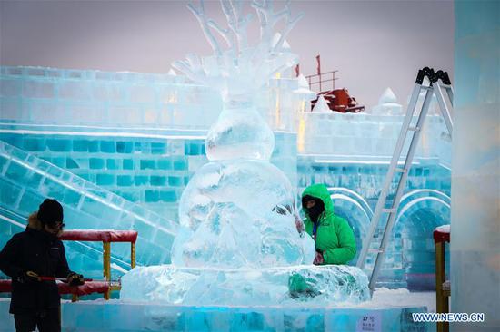 Competitors create a work during the 34th Harbin International Ice Sculpture Competition in the Harbin Ice and Snow World in Harbin, northeast China's Heilongjiang Province, Jan. 8, 2020. The 34th Harbin International Ice Sculpture Competition concluded in Harbin on Wednesday. The ice sculpture made by a Russian team won the first prize at the end of the competition. (Xinhua/Wang Song)