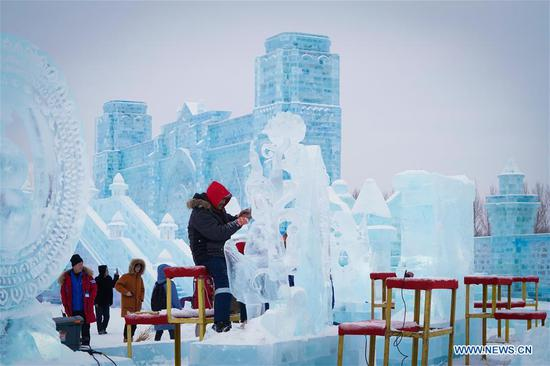 A competitor creates a work during the 34th Harbin International Ice Sculpture Competition in the Harbin Ice and Snow World in Harbin, northeast China's Heilongjiang Province, Jan. 8, 2020. The 34th Harbin International Ice Sculpture Competition concluded in Harbin on Wednesday. The ice sculpture made by a Russian team won the first prize at the end of the competition. (Xinhua/Wang Song)
