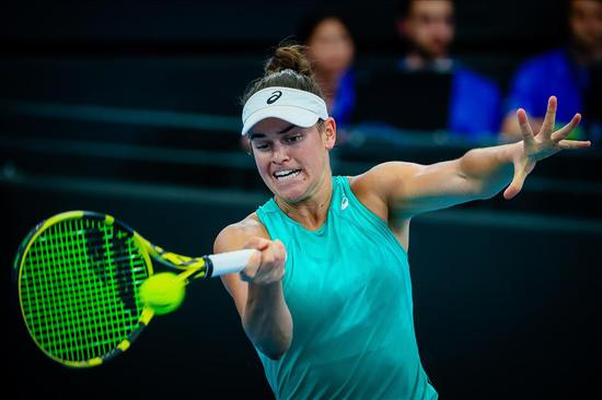 Jennifer Brady hits a return against Ashleigh Barty of Australia during their second-round match at the Brisbane International in Brisbane, Queensland, on Thursday. The American won 6-4, 7-6 (4).