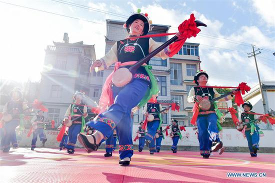 Local villagers rehearse for a gala in celebration of the upcoming Chinese Lunar New Year at Huilongshan Village, Bixi Township, Nanjian Yi Autonomous County, Dali Bai Autonomous Prefecture, southwest China's Yunnan Province, Jan. 8, 2020. (Photo by Shi Zhihong/Xinhua)