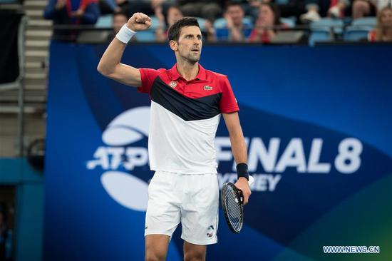 Novak Djokovic of Serbia reacts during the ATP Cup semifinal match against Daniil Medvedev of Russia in Sydney, Australia, on Jan. 11, 2020. (Xinhua/Zhu Hongye)