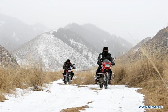 Ranger Feng Dejun (L) and Zhang Detuan patrol in the Qilian Mountains in Jinchang County, northwest China's Gansu Province, Jan. 15, 2020. Located deep in the Qilian Mountains in Jinchang County, there is a natural resource protection station with nine rangers, who patrol over 20 times every month with the longest round-trip distance up to 50 kilometers. And in the winter, a critical period for forest fire prevention, they often have to patrol on foot as it is too dangerous to ride motorcycles on some parts of snow-covered mountain roads. (Xinhua/Ma Ning)