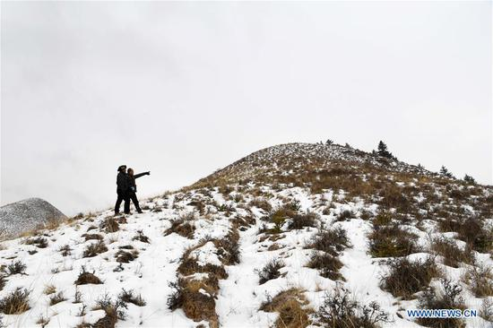Ranger Feng Dejun (R) and Zhang Detuan patrol in the Qilian Mountains in Jinchang County, northwest China's Gansu Province, Jan. 15, 2020. Located deep in the Qilian Mountains in Jinchang County, there is a natural resource protection station with nine rangers, who patrol over 20 times every month with the longest round-trip distance up to 50 kilometers. And in the winter, a critical period for forest fire prevention, they often have to patrol on foot as it is too dangerous to ride motorcycles on some parts of snow-covered mountain roads. (Xinhua/Ma Ning)