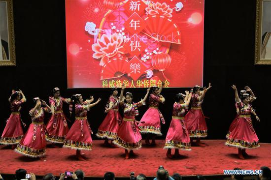 Artists perform during the celebration of the upcoming Chinese New Year in Kuwait City, Kuwait, on Jan. 18, 2020. Overseas Chinese in Kuwait celebrated the upcoming Chinese New Year here on Saturday. (Xinhua/Nie Yunpeng)