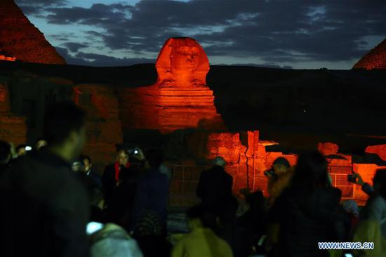 The Sphinx is illuminated in red in Giza, Egypt, on Jan. 23, 2020. The Pyramids and the Sphinx in Giza near Cairo have been shining in red in a ceremonial sound and light show on Thursday evening as part of the celebrations of China's Spring Festival, also known as the Chinese New Year. (Xinhua/Ahmed Gomaa)