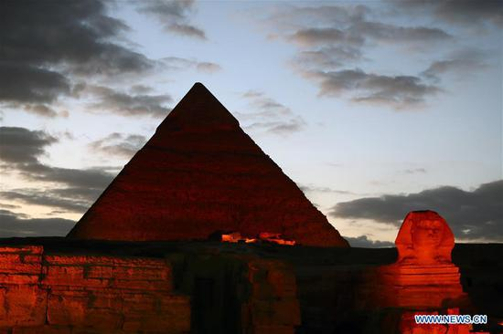 The Sphinx and a pyramid are illuminated in red in Giza, Egypt, on Jan. 23, 2020. The Pyramids and the Sphinx in Giza near Cairo have been shining in red in a ceremonial sound and light show on Thursday evening as part of the celebrations of China's Spring Festival, also known as the Chinese New Year. (Xinhua/Ahmed Gomaa)