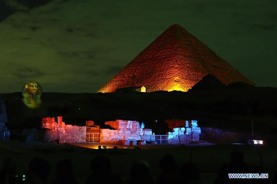 A pyramid is illuminated in red in Giza, Egypt, on Jan. 23, 2020. The Pyramids and the Sphinx in Giza near Cairo have been shining in red in a ceremonial sound and light show on Thursday evening as part of the celebrations of China's Spring Festival, also known as the Chinese New Year. (Xinhua/Ahmed Gomaa)