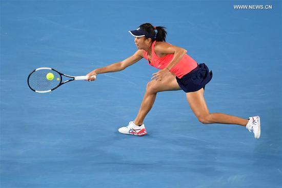 Zhang Shuai hits a return during the women's singles third round match between Sofia Kenin of the United States and Zhang Shuai of China at the 2020 Australian Open tennis tournament in Melbourne, Australia, Jan. 24, 2020. (Photo by Bai Xue/Xinhua)