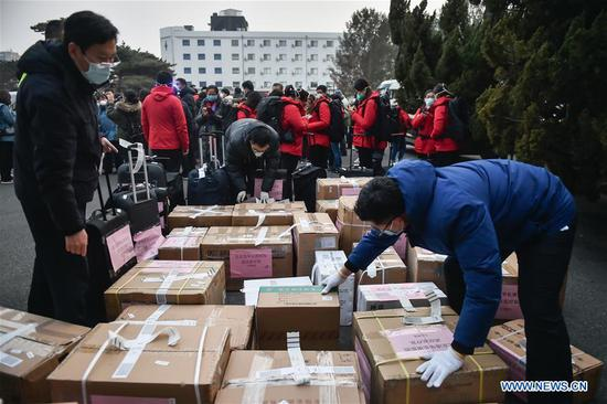 Staff members sort out medical goods for Wuhan City of Hubei at Beijing Capital International Airport in Beijing, capital of China, Jan. 27, 2020. A team comprised of 136 medical workers from Beijing left for Wuhan City on Monday to aid the novel coronavirus control efforts there. (Xinhua/Peng Ziyang)