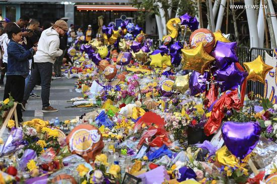 Mourners gather near the Staples Center to pay respect to Kobe Bryant, in Los Angeles, California, the United States, on Jan. 29, 2020. Retired NBA star Kobe Bryant was one of nine people killed in a helicopter crash amid a foggy condition in the hills above Calabasas, southern California, on Jan. 26, 2020. (Xinhua/Li Ying)