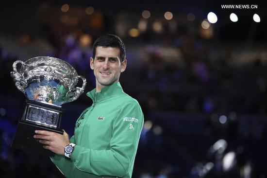 Novak Djokovic of Serbia poses with the trophy during the awarding ceremony after the men's singles final against Dominic Thiem of Austria at 2020 Australian Open in Melbourne, Australia on Feb. 2, 2020. (Xinhua/Bai Xuefei)